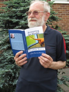 John reading one of his own books